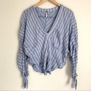 Free people V neck rounded hem striped blouse
